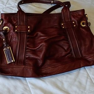 B. Makowsky rustic brown leather bag